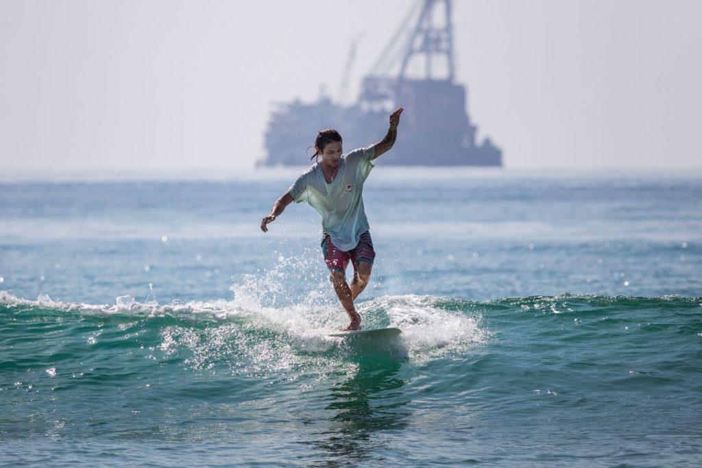 surfing in Hainan ri yue wan sun moon bay