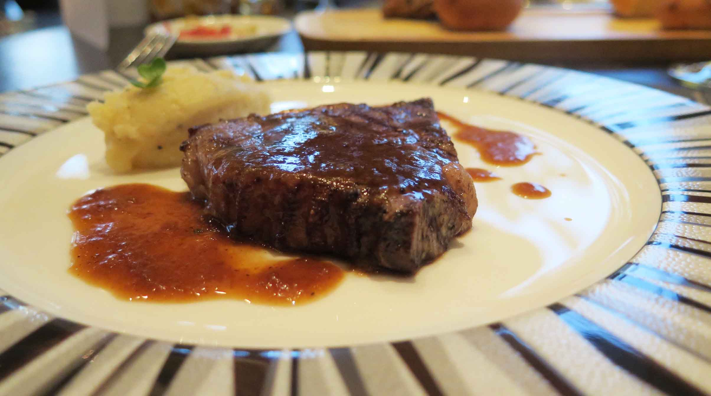 Grilled Rib Eye with Mashed Potatoes, Truffle Oil and Pepper Sauce