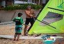 Things to do in Haikou man teaching boy how to windsurf