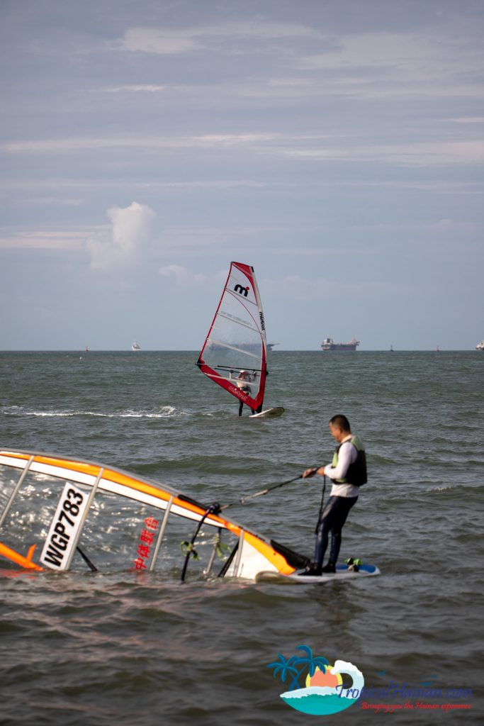 two windsurfers in the ocean