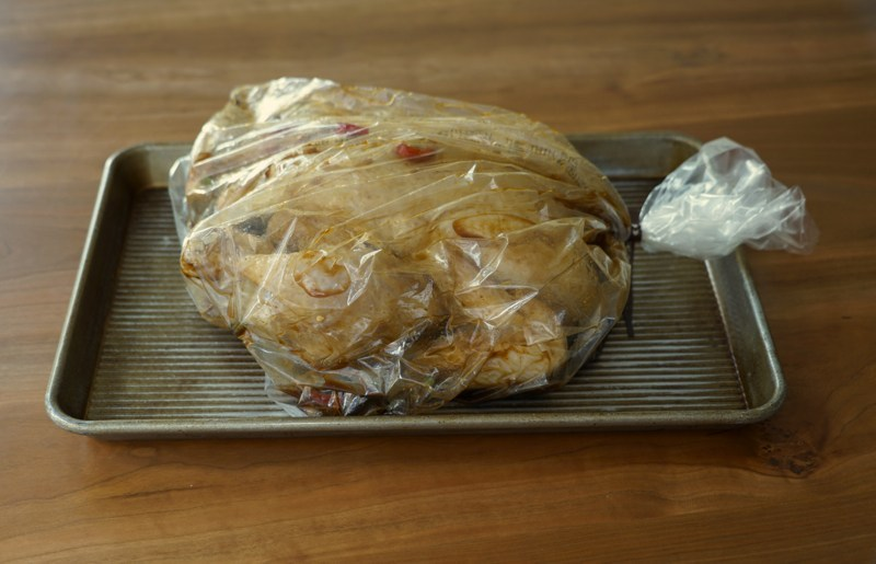 Marinade the chicken in a sealable bag, push out all the air and seal the bag