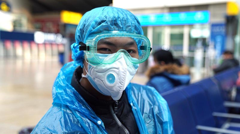 Travelers in Beijing are wrapping themselves in plastic to avoid getting infected